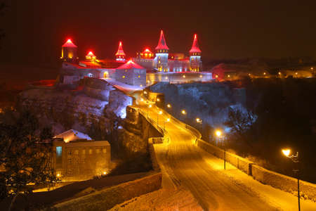 The picture was taken at night in the city of Kamenetz-Podolsk in the Ukraine. The picture shows the incredible beauty of the castle, illuminated with colored spotlights.