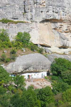 The photo was taken in a mountainous area of the Crimean peninsula. The picture shows the original property is used in the roof as the mountain itself.