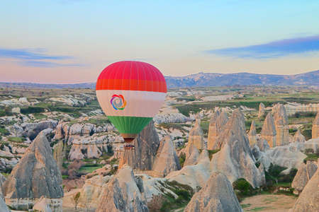 The photo was taken in Turkey, in the name of Cappadocia. The picture shows the flight of balloons over a mountain valley at dawn.