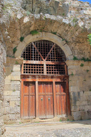 Photo taken in Turkey. The picture shows the old gate at the entrance to the ancient Roman amphitheater in the city of Side.