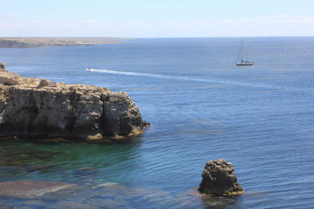 A picture is done on a peninsula Crimea. In the district of cape of Tarkhankut. High rocks block up an outlet to the sea. 免版税图像