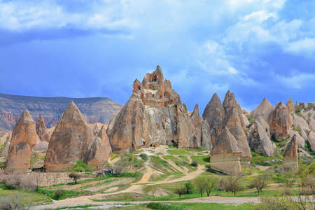 Photo taken in Turkey. The picture shows a rural landscape with cave dwellings in Mountain Cappadocia.