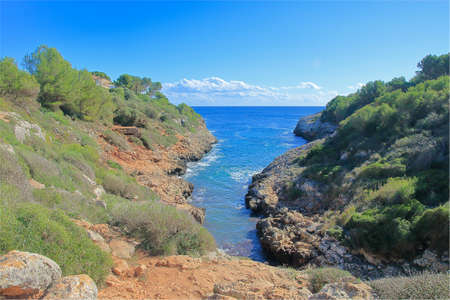 The photo shows a small natural bay on the picturesque coast of the island of Palma de Mallorca.