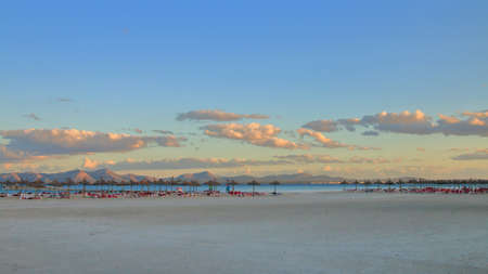 The photo was taken on the Spanish island - Palma de Mallorca. The picture shows an evening on the deserted beach of the island in the off-season.