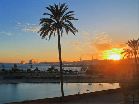 Photo taken on the island of Palma de Mallorca. The picture shows the sunset over the coast of Valletta.