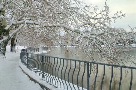 A trail along the lake in a winter public park in the city of Odessa, called Victory Park.