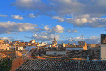Photo taken on the island of Palma de Mallorca in the old town of Alcudia. The picture shows the tiled roofs of the old city at sunset day.