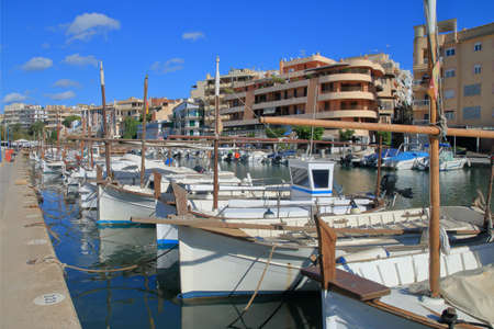 Pictured are traditional boats moored in one of the many marinas of the island of Palma de Mallorca.