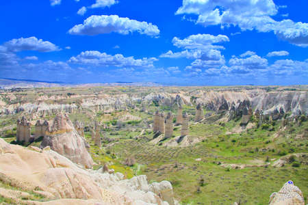 The photo was taken in the mountains of Cappadocia in Turkey. The picture shows a fantastic landscape of mountainous highlands under a beautiful sky. 免版税图像