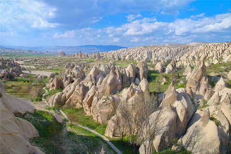 The photo was taken in Turkey, near the city of Goreme. The photograph shows the landscape of a valley in mountain Cappadocia under an incredibly beautiful sky.