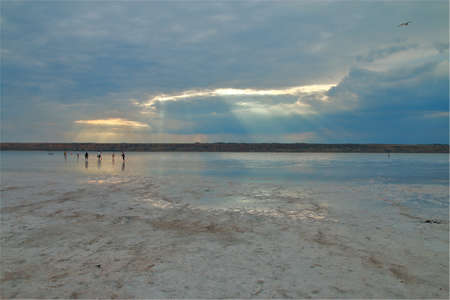 The photo was taken near the city of Odessa in Ukraine. The picture shows a walk through a salty estuary called Khadzhibeyevsky on a rainy day.