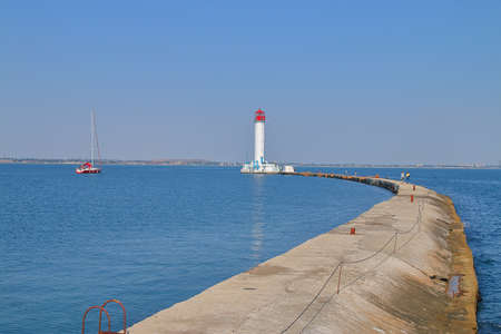 Photograph taken in Odessa seaport. The picture shows a concrete pier leading to the Odessa lighthouse.