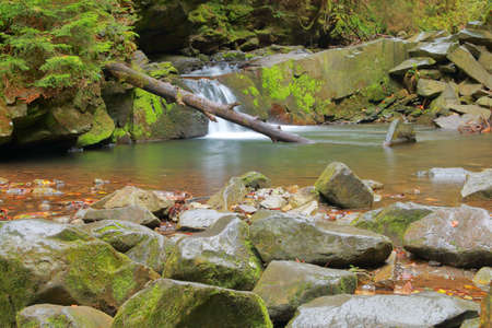 Photo taken in Ukraine in the autumn. In the picture there is a waterfall in the Carpathian mountains called - girlish tears.