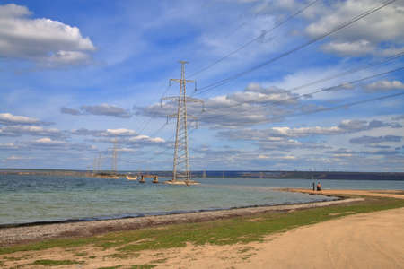 The photo was taken in Ukraine at the Telegulsky estuary. The photo shows the landscape of the estuary with the power transmission towers installed directly in the water. 免版税图像