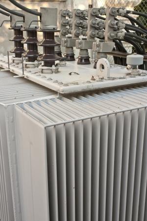 power transformer: Huge industrial high-voltage substation power transformer at an power plant