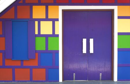 Colorful wooden door of the wood-paneled walls. Stock Photo - 18653921