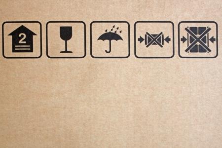 crate: Black fragile symbol on cardboard, brown paper box.