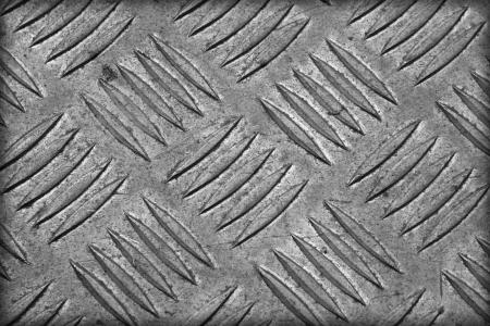 treadplate: Sheet aluminum slip through the old dirt. Stock Photo