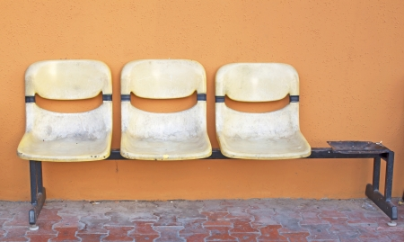 Old leather chairs, yellow walls, a public place. photo