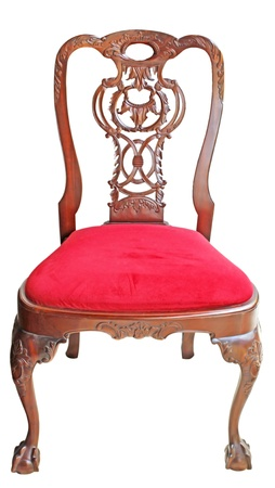 classical carved wooden chair upholstered in leather photo