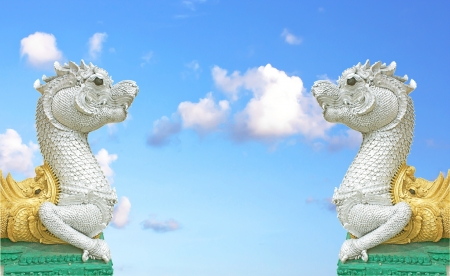 Naga in temple on blue sky background at thailand Stock Photo