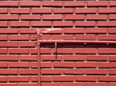 shutoff: Red brick wall with water pipes and shut-off valve open. Stock Photo