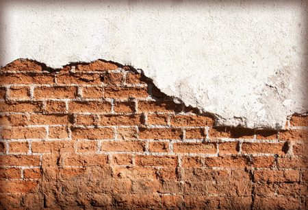 Decayed, cracked concrete vintage brick wall background.