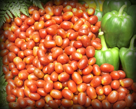 Many red ripe tomatoes and Green bell pepper. photo