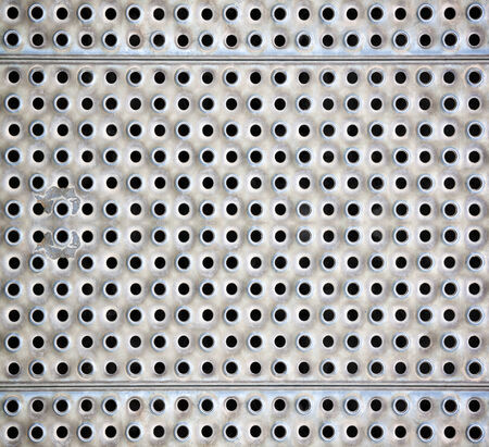 Seamless chrome metal surface, background perforated sheet photo