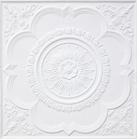 Patterns on the ceiling gypsum sheets of white flowers. photo