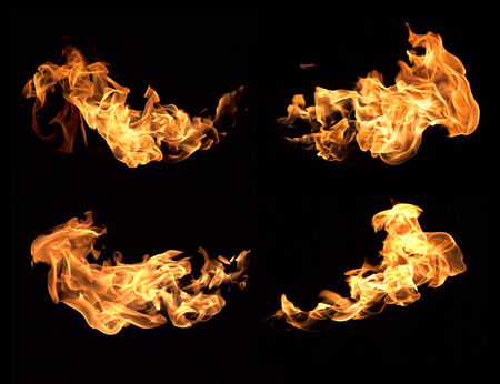 The red flames on a black background. photo