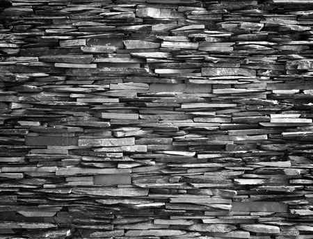 Stone wall background black wall construction stronger. photo
