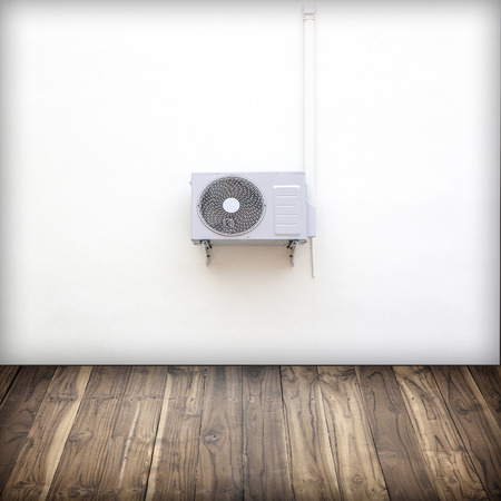 Condenser with white plaster walls and wooden floor background pattern. photo