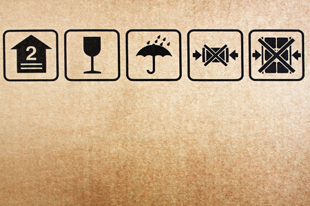 Safety icon on paper box background  brown paper photo