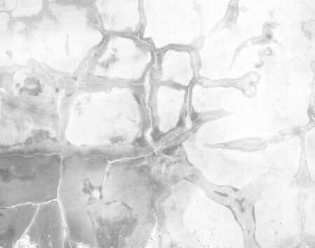 Polished plaster wall cracks construction background texture. Stock Photo
