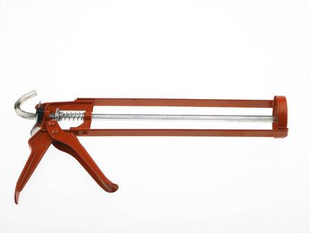 caulking: New Silicone Caulking Guns isolated on white background.