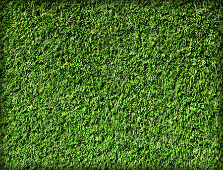 Artificial grass surface pattern background high angle shot.