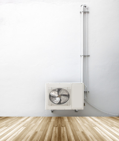 condenser: Condenser with white plaster walls and wooden floor background Stock Photo