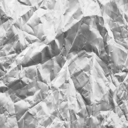 feuille froiss�e: Crumpled sheet of aluminum. Abstract textured background Banque d'images