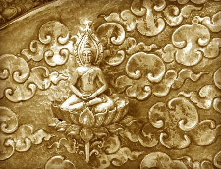 gold metal: metal gold pattern Crafts wall in the temple of thailand, Lanna style Chiang Mai, Thailand. Stock Photo