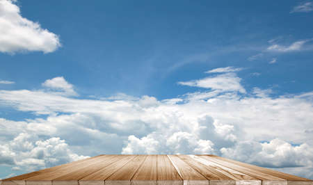 'advertising space': Counter wood floor sky background. Design advertising space