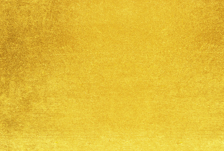 Gold Background / gold polished metal, steel texture. Stock Photo