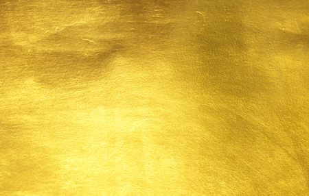 Brillante papel de textura de fondo de color amarillo pan de oro Foto de archivo