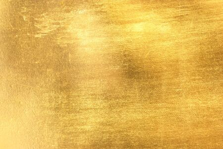 polished: gold polished metal steel texture abstract background.