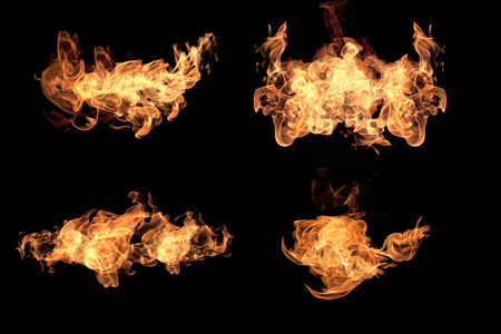 Flames fire burning heat. Isolated on a black background Abstract red light background black textured pattern background. Stock Photo