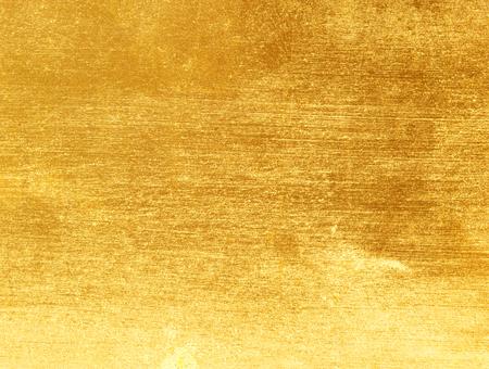 光沢のある黄色葉金箔テクスチャ背景 写真素材