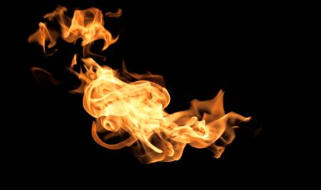 flammable: Fire flames on a black background abstract. Stock Photo