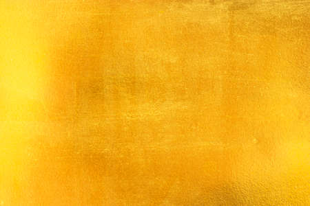 brushed: Shiny yellow leaf gold foil texture background