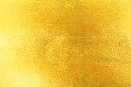 steel plate: Shiny yellow leaf gold foil texture background