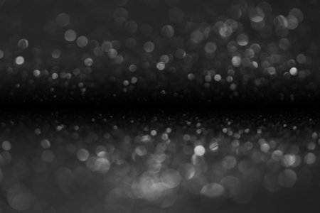 bokeh of water fly and lights on black background